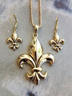 Fleurty Girl - Everything New Orleans - Fleur de Lis Necklace Set, Gold, $12. Simple gold fleur de lis necklace with matching earrings.