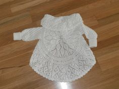 """Pidoca-short for """"Piper's doily cardi""""-is worked in the round from the center out, with afterthought sleeves worked later, top-down and in the round. Sleeve ribbing is extra long, to grow w/the child."""