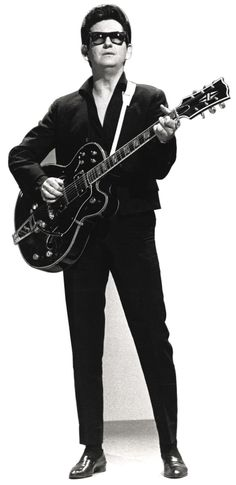"A Cardboard cutout of Roy Orbison wearing sunglasses and playing a guitar in black and white. Roy Orbison played a style known as ""Rockabilly"" much like Elvis. He was known for his powerful and distinctive voice. Rock N Roll, Pop Rock, Style Année 70, Mode Style, Blues, Beatles First Album, Music Is Life, My Music, Hello Music"