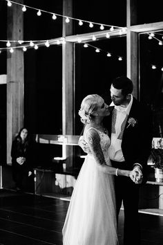 Moonlight Real Bride Kaitlyn and her husband  during their first dance in Moonlight style T693