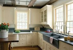 Love the new/old design of homes; and the designer did a great job on this kitchen.