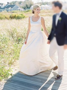 Ivory taffeta sleeveless ball gown wedding dress. Scoop neckline fitted bodice making contrast to the ball gown puffy skirt. Low back.