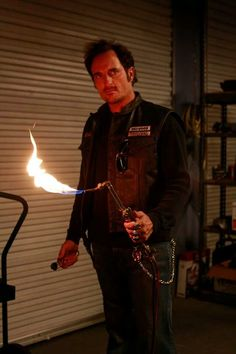 Sons of anarchy Yeah Tig is gonna burn someones tat off!