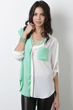 Keep your style classy with the Sherbet Essence Top! This top features semi-sheer chiffon with contrasting color accent throughout, drop wrap placket at front, left breast pocket, cinched detail below yoke, quarter-length sleeves with cuff-up button tab decor, curved hem, and finished with stitching detail