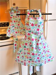 These retro style matching Mother/Grandmother and child full aprons are so cute and ready to make a hit in the kitchen. The matching aprons look good enough to eat with the colorful cupcakes on an aqua background that has small white polka dots. The ties at the neck and waist are extra long to make lovely bows. You will both look adorable baking and cooking in the kitchen. .   Adult sizes small, medium, large and extra large and childrens sizes 1-2, 3-4, 5-6, and 7-8. Please indicate the...