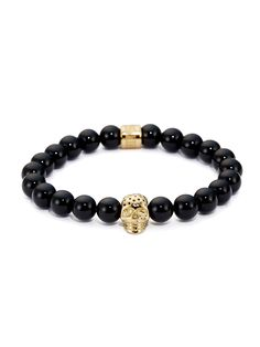 This unique charm bracelet is made with semi precious black onyx stones and is contrasted by the gold tones of our handcrafted perforated skull design, a gold loop with our logo carved in finishes this bracelet perfectly & is a great addition to any jewellery collection.