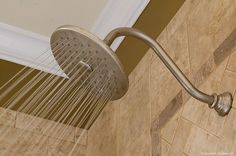 A luxurious shower head in the master walk-in shower. Plan #1125-D - The Cedar Ridge. http://www.dongardner.com/plan_details.aspx?pid=3151. #Master #Bathroom #WalkinShower