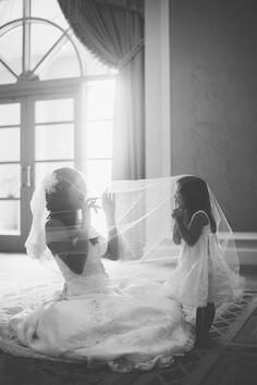 A precious moment between a #bride and her #flowergirl underneath the veil.  For more flower girl tips, tricks, inspiration & ideas, visit us at www.flowergirlworld.com!