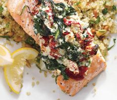 Salmon Florentine -  2 pkg (10 oz ea) frozen spinach, thawed, 1 T. olive oil, 1/4 cup minced shallots, 2 t. minced garlic, 5 sun-dried tomatoes, chopped, 1/2 t. salt, 1/4 t. red pepper flakes, 1/4 t. freshly ground black pepper, 1/2 cup part-skim ricotta, 4 skinless salmon fillets (6 oz ea), rinsed and patted dry. Serve with Quinoa Pilaf with Pine Nuts
