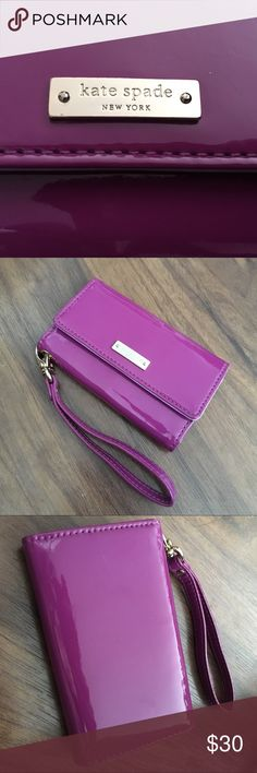 "Kate Spade iPhone SE (5, 5S) wristlet wallet Authentic Kate Spade tech wallet/clutch for iPhone 5, 5S, or SE. Holds 3 cards & has a small pocket for cash. Removable wrist strap. Snap closure. I got this from another Posher, but I need something bigger. Measures 5"" long by 3.25"", 8.75"" when open. No camera hole on the back. Purple patent leather is in excellent condition. Gold hardware has some tiny scratches. The lilac/lavender interior shows slight wear that I'm having trouble…"