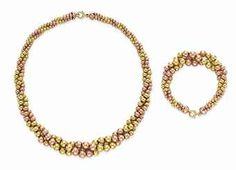 Huguette Clark ;SET OF BI-COLORED GOLD JEWELRY Comprising a necklace, designed as three twisted strands of yellow and rose gold beads; and a bracelet en suite, mounted in yellow and rose gold, necklace 18 ins., bracelet $8,125.00