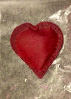 Heart shaped beet ravioli with asparagus filling