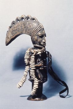 Yoruba Ogo Elegba (Eshu Staff), Nigeria .In the Yoruba tradition the god 'Eshu' is a mischievous trickster figure who enjoys confusion on a cosmic scale . Many stories tell of tricks he plays that cause arguments . In one myth he lured the sun and moon into changing places, which upset the cosmic order. 'Eshu' is the god of change, chance, and uncertainty.