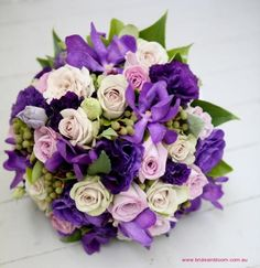 BG123 Purple lisianthus, mushroom `Creme de Menthe` roses, mauve `Pacific Blue` roses, purple Vanda orchids, and berzillea berry