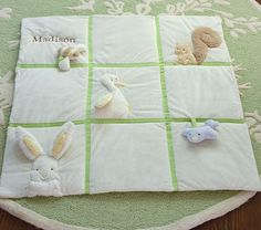 "Critter Playmat - 34"" square  Padded play mat is sewn of soft velboa with canvas backing.  Each three-dimensional animal has play value; the rabbit's ear crinkles, the bird rattles,  the bee squeaks, the squirrel has a fluffy tail, and the duck has a wing to hold on to."