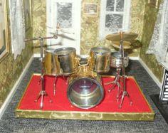 Miniature dollhouse vintage drum kit on stage