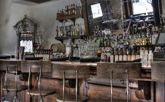 angled mirrors behind the bar