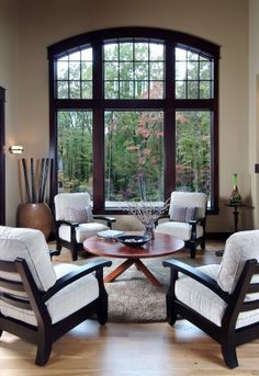 A great room to see through the two story windows out into a lovely wooded view. A comfortable & lovely room with a great view.