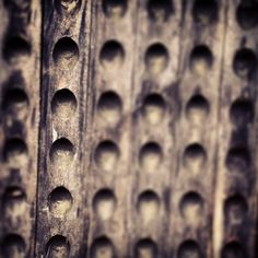 Old battered wooden wine rack (tilt shift focus)