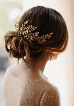 Brown + Brooch + Dramatic Side Sweep + Low Angular Half Circle Bun