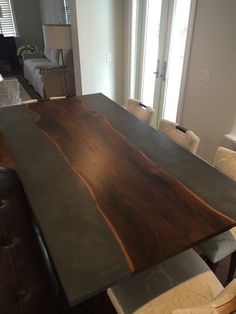 910 Castings - Concrete dining table with live edge slab