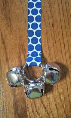 Blue polka dots. https://www.etsy.com/listing/186222132/door-bells-for-your-doggie-white-ribbon