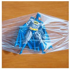 """Trapped Batman No. 5 Artist Simon Monk's """"Trapped In Bags"""" pieces arose from his interest in scale and representation. Despite being depicted exactly life size, the subjects themsel Hyper Realistic Paintings, Batman, Hyperrealism, Play, Action Figures, Geek Stuff, Plastic, Superhero, Toys"""