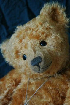 WORN AROUND THE EDGES----WELL LOVED TEDDY