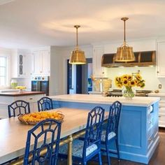 Wide Plank White Oak island with custom Brass table base. Perfectly proportioned kitchen.The hub of the home.