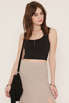 In a stretchy cotton-blend knit, this crop top features a sleeveless cut, scoop neckline, and a scoop back.