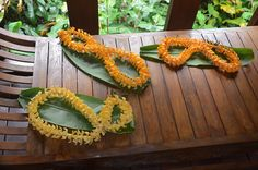 puakinikini lei on ti leaves, gifts from the bride and groom to guests not yet arrived Flower Lei, Garden Of Eden, Leis, Island Weddings, Fresh Flowers, Maui, Hawaiian, Elopements, Groom