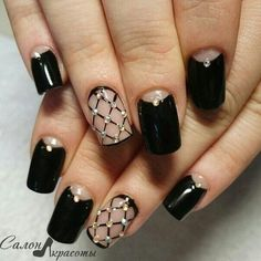 fancy black with crystals and criss cross pattern nail design