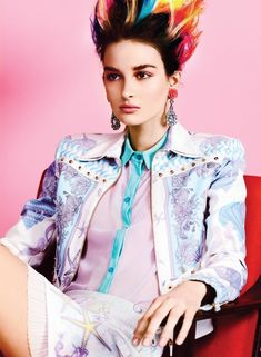 Mad About Hue – Max Abadian captures model Eve with a punk inspired hairdo for the May issue of Flare Magazine. Styled by Elizabeth Cabral in designs from the likes of Versace, Miu Miu and Marni; the beauty rocks a colorful shock of hair created by hair stylist Tony Masciangelo against pastel backdrops.