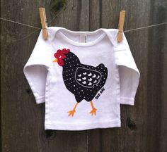 Dotty Chicken Hand Silkscreened Long Sleeve Baby Tee. $18.00, via Etsy.    I want to buy this for Elsie and make her a little red skirt to go with it.  Since all the other kids are too big for it, and it's too adorable to ignore!