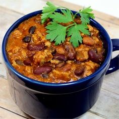 Laura's Quick Slow Cooker Turkey Chili - Allrecipes.com  CHANGED: substituted 1 14-oz can fire roasted tomatoes for one of the cans of tomato soup  ADDED: 1/2 can water, extra 1/4 tsp red chili flakes, several dashes cayenne pepper, 1 4-oz can diced green chiles, 1 cup frozen corn