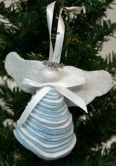 this could be done with yo yo's..... Easy Angel Crafts - Felt Circles Angel hanging on tree.... This angel using the felt and pattern took an hour to make,,,, easy just a long time....