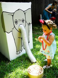 "Feed the elephant game for very young party guests. Child puts in peanut or candy circus peanut (allergies) in the dryer vent hose nose. Older child or adult inside box tosses out prize ticket or small prize out the hose nose. Different version of ""fishing game"""