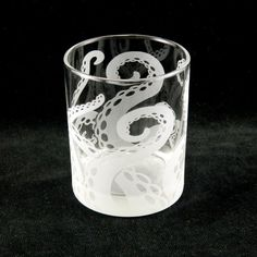 Every beautiful glass is masked and etched to carve in Embracing Tentacles (an original design by Jeffrey Woods) into the surface of the glass. Each