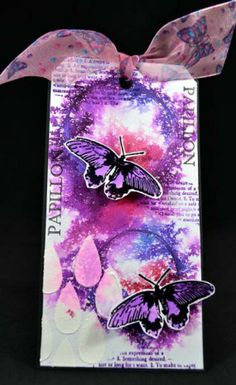 Gorgeous die cut butterflies on tag colored with shades of purple