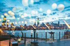 We love this photo that reflects the hanging globe lanterns hanging inside Cafe Galileo while looking out to the famous Chicago cityscape. Photography by Maypole Studios.