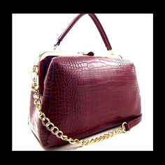 Magenta Hard Frame Bag This gorgeous bag features a push lock snap button closure. Looks like a doctors satchel. Textured crocodile faux leather material. Metal frame accent, metal top frame, fully lined with zipper pockets, gold tone  hardware, long adjustable strap. Interior has 2 zipper pockets and 2 slip pockets, exterior has one rear zipper pocket, size: 11.5 L X 7 W X 8.5 H. (This closet does not trade or use PayPal) Bags Satchels