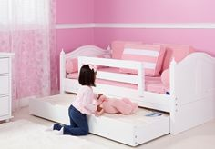 Girls White Curve Daybed with trundle for sleepovers.