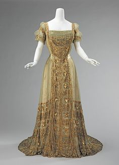 Opulent Ball Gown of Bronze Silk; Overdress Embroidered with Dense Gold Sequin & Bead Decoration. American, 1910.