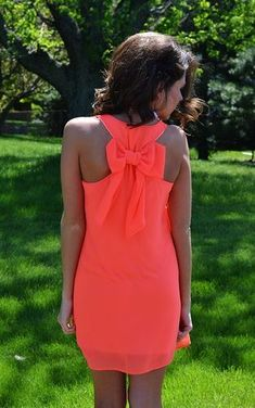 coral dress with bow in   back