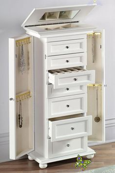 Home Decorators Collection Hampton Harbor White Jewelry Armoire-4591540410 - The Home Depot  <br> Carefully crafted of solid wood and wood veneer is the Hampton Harbor White Jewelry Armoire. It also features crown molding, recessed-panel drawers and bun feet to complete its classic design. You can hold many items in the four small and three drawers. It also includes a lift-top compartment with a mirror and side compartment with hooks for necklaces. Armoire Cabinet, Jewelry Cabinet, Jewelry Armoire, Jewelry Closet, Jewelry Drawer, White Furniture, Furniture Decor, Bedroom Furniture, Furniture Storage