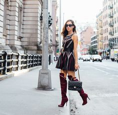 Sydne Style wears over the knee boots for fall trends at fashion week