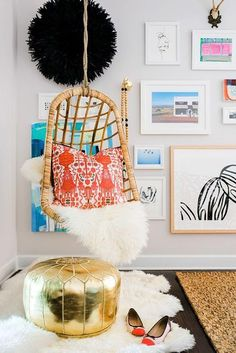 A wicker hanging chair + gallery walls pair perfectly!
