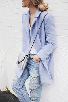 Mary Seng is wearing a pale blue double breasted coat from TopShop