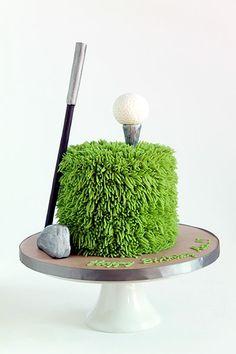 Golf themed birthday cake or groom's cake with golfers green, golf ball and fondant golf club.