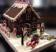 """When you stop by be sure to register for a chance  to win our handcrafted  chocolate """"gingerbread""""  house.  No purchase necessary!  The winner will be announced via our Facebook page and email on December 6 so you will have plenty of time to nibble on it throughout the holiday season."""